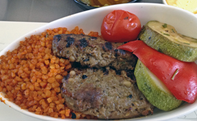 Turkish style grilled minced beef served with sautéed zucchini, red peppers and bulgur