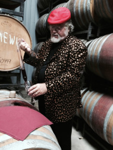 Paul using a thief to remove wine from an oak barrel