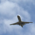 Plane flies over Autry Cellars
