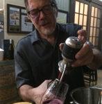 Dave Zuchero pours a wine tasting.